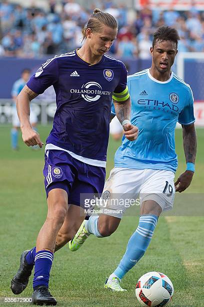 Midfielder Brek Shea of Orlando City FC and forward Khiry Shelton of New York City FC vie for the ball during the match at Yankee Stadium on May 29...