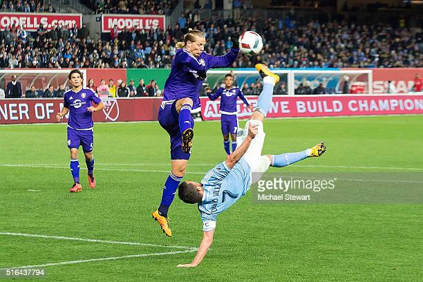 Midfielder Brek Shea of Orlando City SC defends against forward David Villa of New York City FC during the Orlando City SC vs New York City FC match...