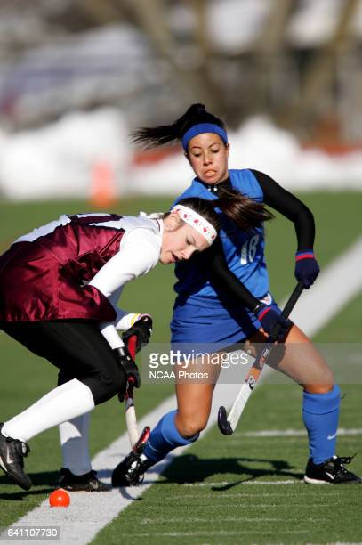 Midfielder Brittney Fox of Bloomsburg University and midfielder Cristina Sergi of Bentley College battle for the ball during the Division II Women's...