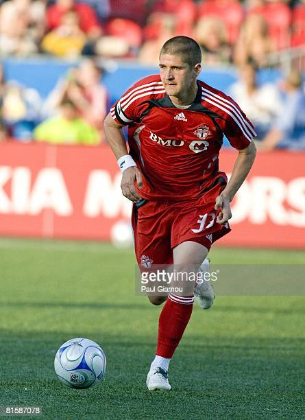 Midfielder Carl Robinson of Toronto FC runs with the ball during the game against the Colorado Rapids on June 14 2008 at BMO Field in Toronto Canada