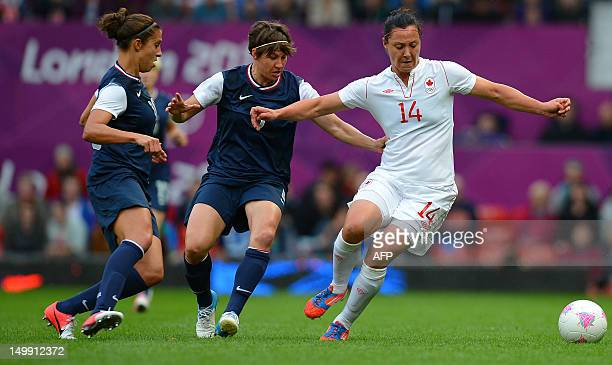 US midfielder Carli Lloyd and defender Amy LePeilbet vie with Canada's forward Jonelle Filigno during the London 2012 Olympic Games womens semi final...