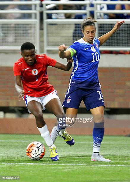 US midfielder Carli Lloyd battles for possession of the ball with Haiti's midfielder Roselord Borgella in the first half of the International...