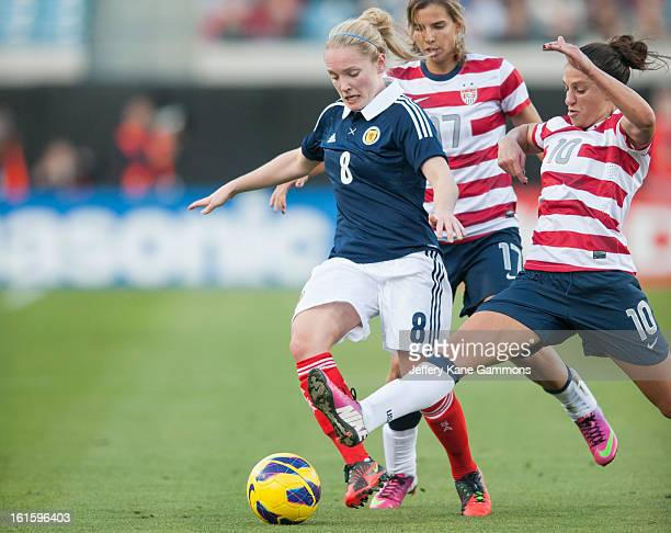 Midfielder Carli Lloyd of the United States attempts to steal the ball from Midfielder Kim Little of Scotland during the game at EverBank Field on...