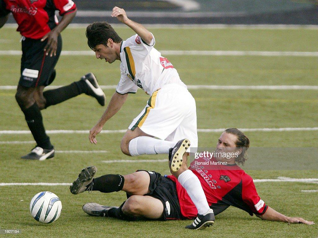 Deering sweeps ball away : News Photo