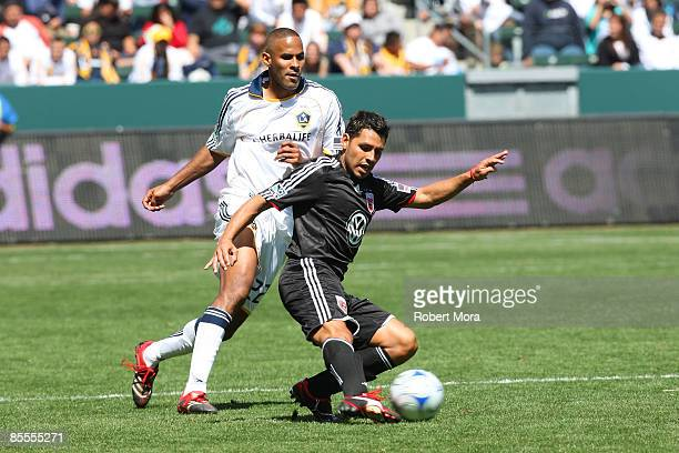 Midfielder Christian Gomez of DC United manuvers against Tony Sanneh of the Los Angeles Galaxy DC during their MLS game at Home Depot Center on March...