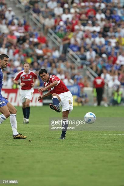 Midfielder Christian Gomez of the MLS AllStars kicks the ball against the Chelsea Football Club during the Sierra Mist MLS AllStar friendly match on...