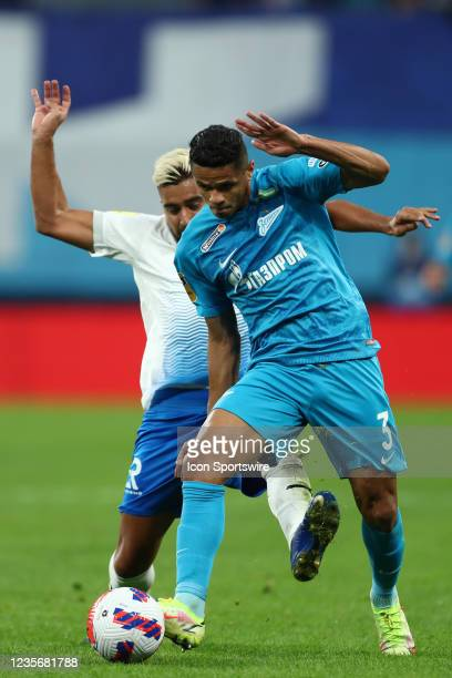 Midfielder Christian Noboa of FC Sochi and defender Douglas Santos of FC Zenit vie for the ball during Russian Premier League match FC Sochi v FC...