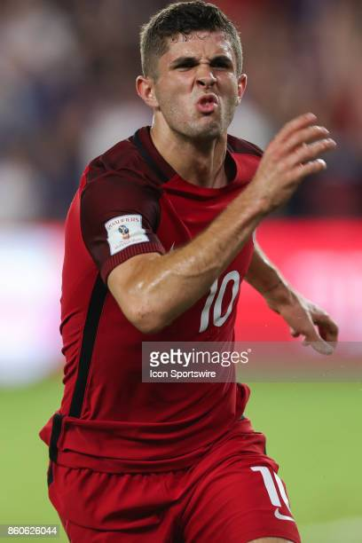 USA midfielder Christian Pulisic reacts after scoring a goal during the World Cup Qualifying soccer match between the US Mens National Team and...