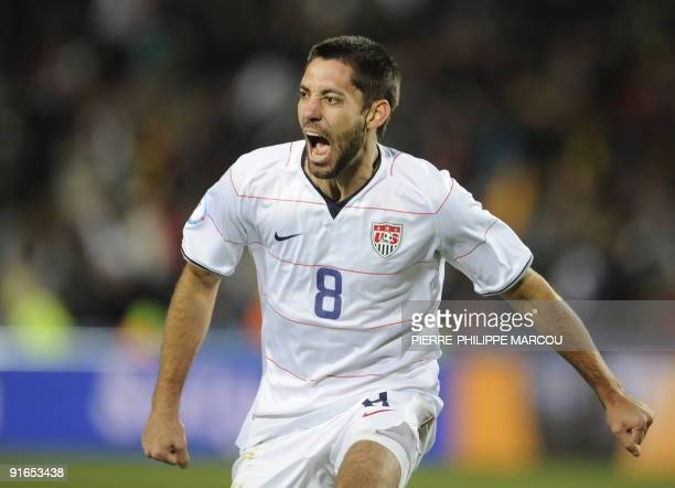 US midfielder Clint Dempsey celebrates after he scored the first goal during the Fifa Confederations Cup final football match United States against...