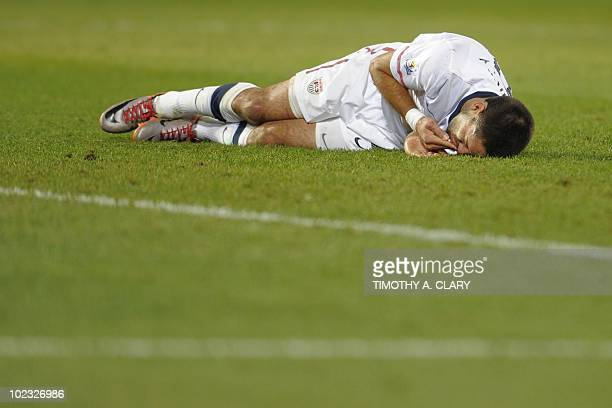 US midfielder Clint Dempsey gets a bloody lip from his lip after he was hit during the Group C first round 2010 World Cup football match USA vs...