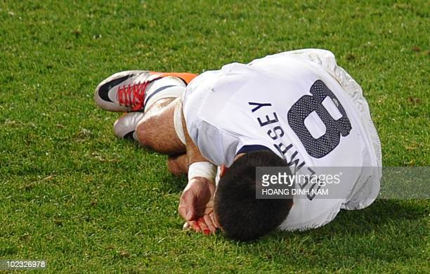 US midfielder Clint Dempsey gets blood from his lip after he was hit during the Group C first round 2010 World Cup football match USA vs Algeria on...