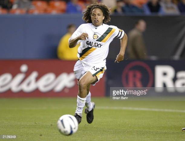 Midfielder Cobi Jones of the Los Angeles Galaxy dribbles the ball against the Colorado Rapids during the MLS game at Invesco Field at Mile High on...