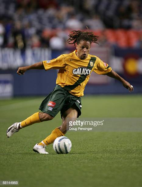 Midfielder Cobi Jones of the Los Angeles Galaxy dribbles the ball against the Colorado Rapids during the game at Invesco Field at Mile High Stadium...