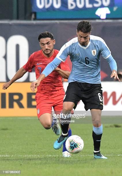 USA midfielder Cristian Roldan and Uruguay midfielder Rodrigo Bentancur compete for the ball during an exhibition soccer match between the US Mens...