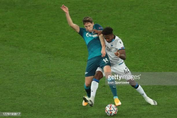 Midfielder Daler Kuzyaev of FC Zenit and forward Emmanuel Dennis of FC Brugge during UEFA Champions League match Group stage, Group F FC Zenit v FC...