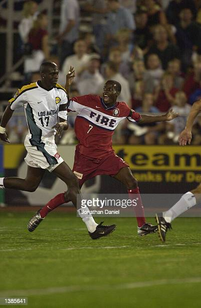 Midfielder DaMarcus Beasley of the Chicago Fire complains to the referee as he is marked by defender Ezra Hendrickson of the Los Angeles Galaxy...