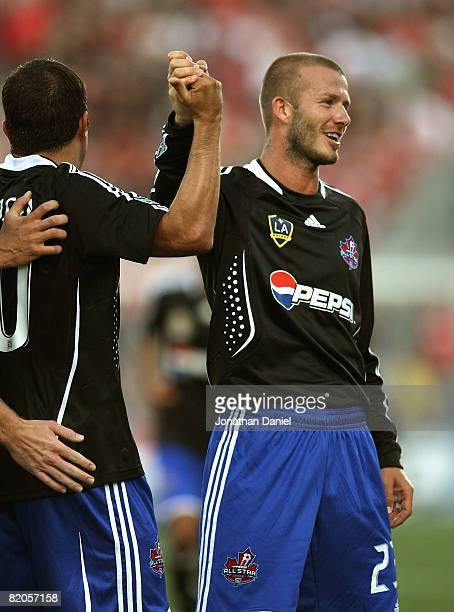 Midfielder David Beckham of L.A. Galaxy congratulates midfielder Cuauhtemoc Blanco of Chicago Fire after a goal during the 2008 Pepsi MLS All Star...
