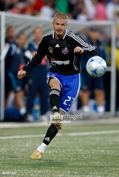 Midfielder David Beckham of L.A. Galaxy crosses the ball during the 2008 Pepsi MLS All Star Game between the MLS All Stars and West Ham United at BMO...