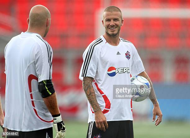360f76abc7bd Midfielder David Beckham of LA Galaxy with the ball during a MLS All Star  training session