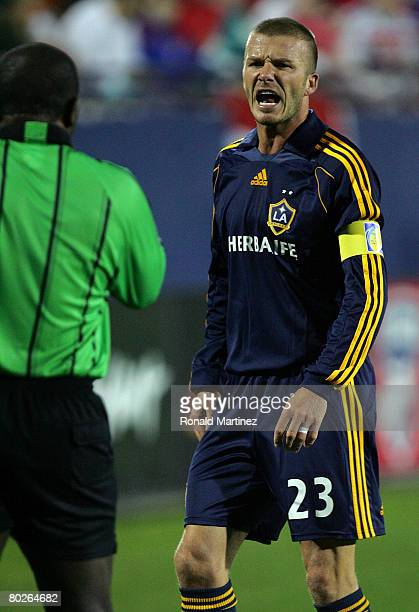 Midfielder David Beckham of the Los Angeles Galaxy yells while receiving a yellow card against FC Dallas during a charity preseason match on March...