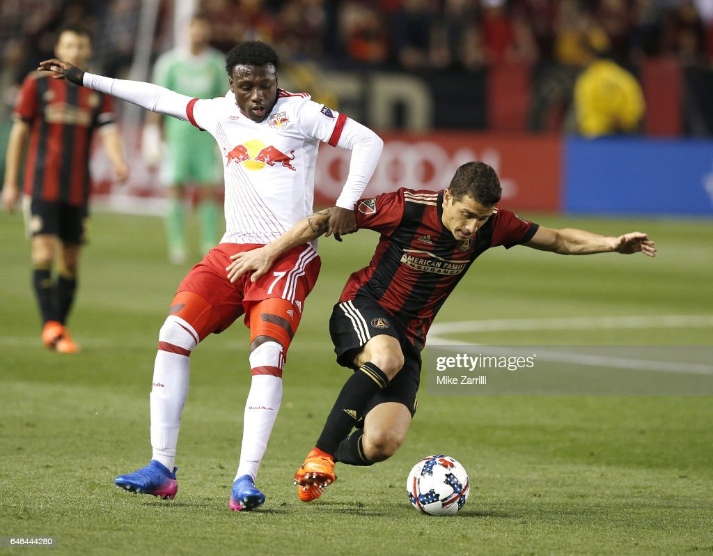 Midfielder Derrick Etienne, Jr. #7 of the New York Red Bulls battles for the ball with midfielder Carlos Carmona #14 of Atlanta United during the game at Bobby Dodd Stadium on March 5, 2017 in Atlanta, Georgia.