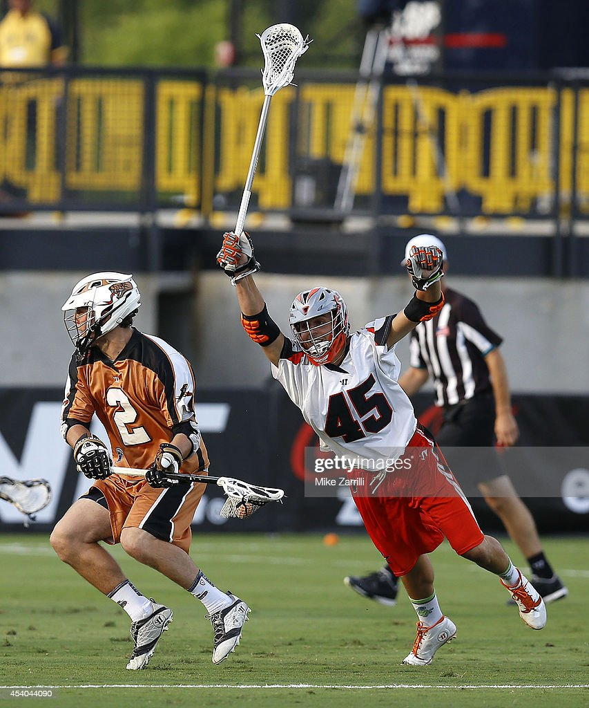 Midfielder Dominic Sebastini #45 of the Denver Outlaws dives towards midfielder John Lawson #2 of the Rochester Rattlers during the 2014 Major League Lacrosse Championship Game at Fifth Third Bank Stadium on August 23, 2014 in Kennesaw, Georgia.