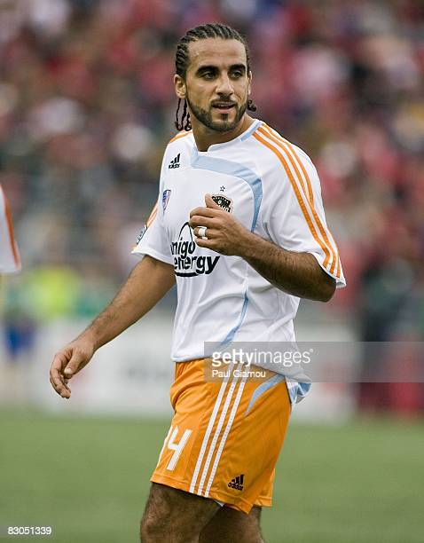 Midfielder Dwayne De Rosario of the Houston Dynamo follows the play during the match against Toronto FC on September 27, 2008 at BMO Field in...