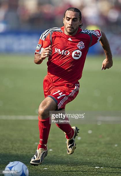 Midfielder Dwayne De Rosario of the Toronto FC chases the ball during the match against DC United at BMO Field on August 15 2009 in Toronto Canada...