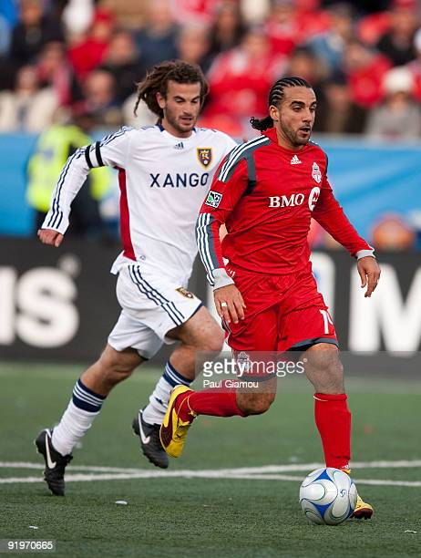 Midfielder Dwayne De Rosario of the Toronto FC fights for the ball with midfielder Kyle Beckerman of Real Salt Lake during the match at BMO Field on...