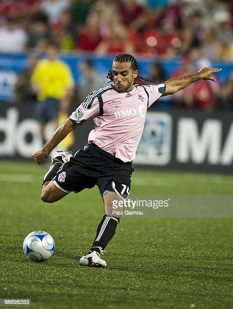 Midfielder Dwayne De Rosario of the Toronto FC kicks the ball during the match against the New York Red Bulls at BMO Field on June 24, 2009 in...