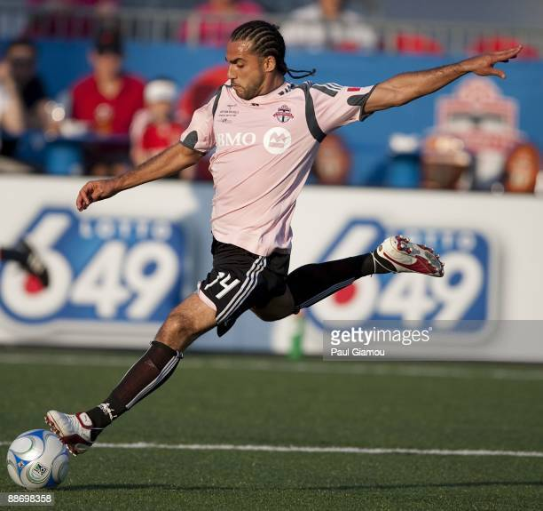 Midfielder Dwayne De Rosario of the Toronto FC kicks the ball during the match against the New York Red Bulls at BMO Field on June 24 2009 in Toronto...