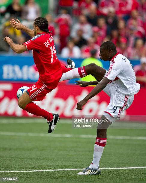 Midfielder Dwayne De Rosario of Toronto FC leaps for the ball with defender Bakary Soumare of the Chicago Fire during the match at BMO Field on May...