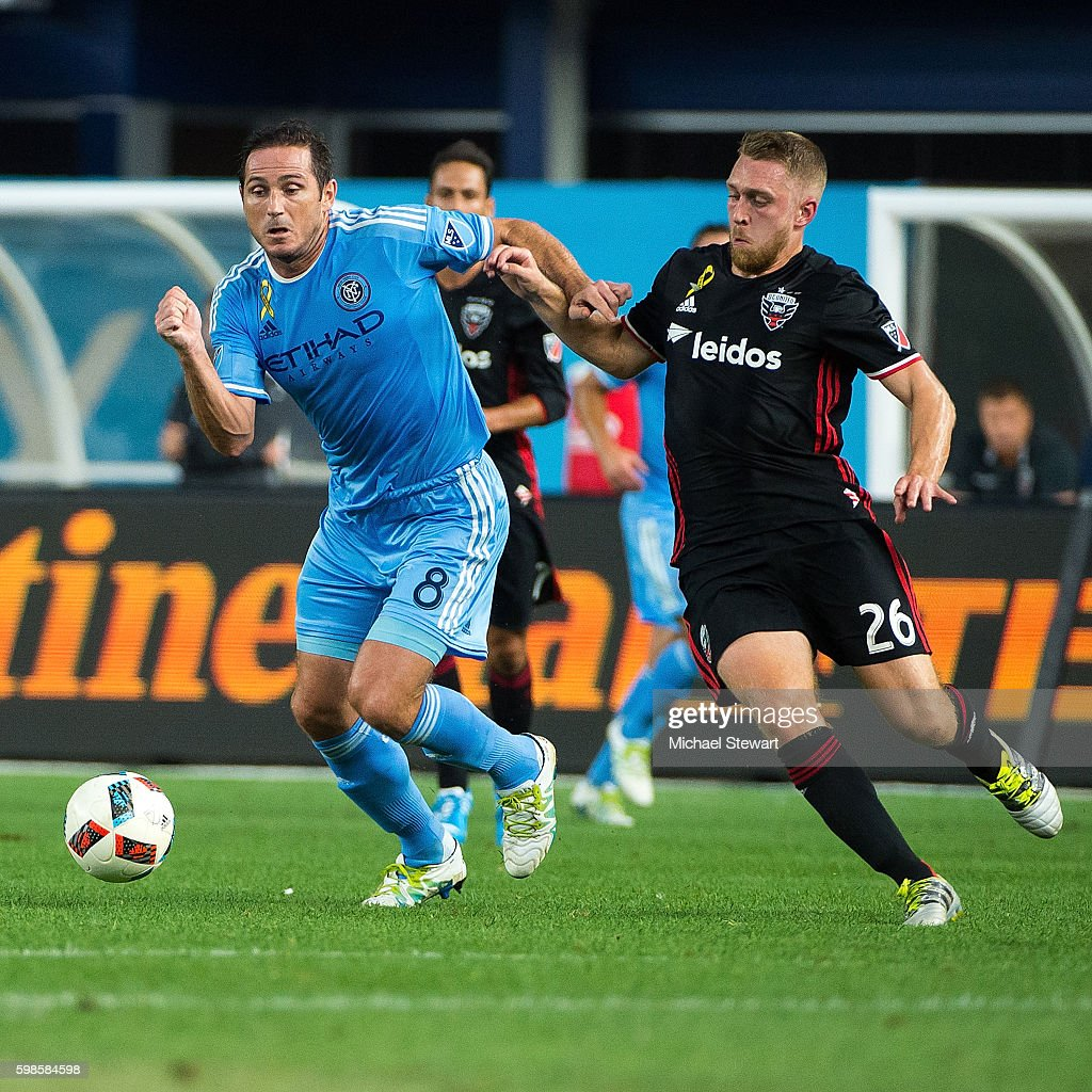 Midfielder Frank Lampard #8 of New York City FC controls the ball past Rob Vincent #26 of D.C. United during the match at Yankee Stadium on September 1, 2016 in New York City. New York City FC defeats D.C. United 3-2.