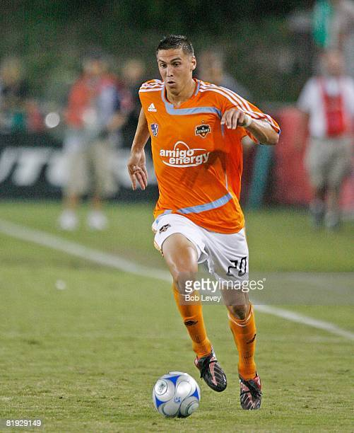 Midfielder Geoff Cameron of the Houston Dynamo brings the ball up the field during SuperLiga against Atlante FC on July 12 2008 in Houston Texas