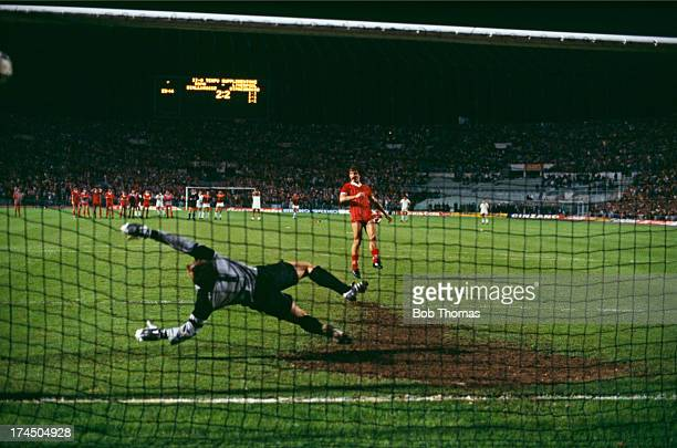 Midfielder Graeme Souness beats Roma goalkeeper Franco Tancredi to score Liverpool's second penalty in the shootout following a 11 draw after extra...