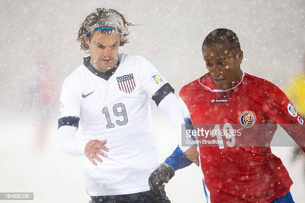 Midfielder Graham Zusi of the United states and defender Roy Miller of Costa Rica battle for the ball during a FIFA 2014 World Cup Qualifier match at...