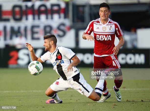 Midfielder Guilherme of Brazilian club Vasco da Gama is tackled by defender Jorge Moreira of Argentine side River Plate during their soccer match for...