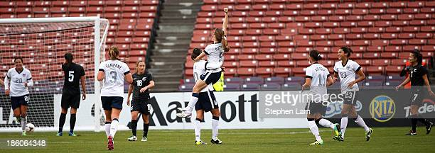 Midfielder Heather O'Reilly of the US Women's National Team celebrates her goal with teammate midfielder Carly Lloyd during the second half of their...
