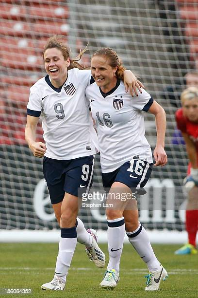 Midfielder Heather O'Reilly of the US Women's National Team celebrates her goal with teammate defender Rachel Buehler during the second half of their...