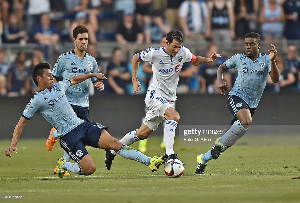 Mid-fielder Ignacio Piatti #10 of the Montreal Impact dribbles the ball up field past mid-fielder Roger Espinoza #27 of Sporting Kansas City during the first half on July 18, 2015 at Sporting Park in Kansas City, Kansas.