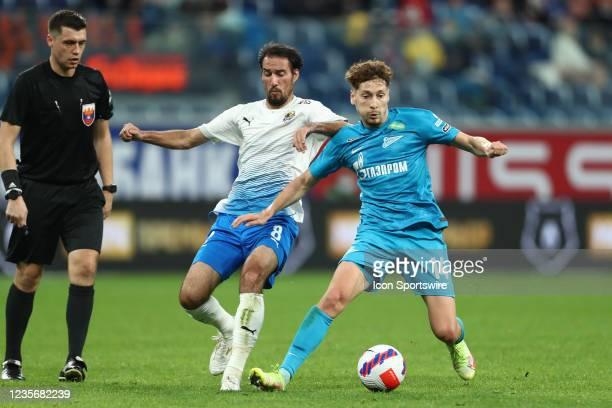 Midfielder Ivelin Popov of FC Sochi and midfielder Daler Kuzyayev of FC Zenit vie for the ball during Russian Premier League match FC Sochi v FC...