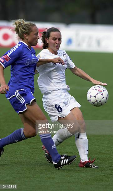 Midfielder Jena Kluegel of the Boston Breakers and midfielder Kelly Golebiowski of the Washington Freedom battle for the ball during the WUSA...