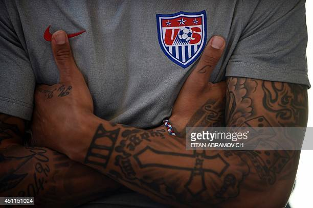 US midfielder Jermaine Jones crosses his arms during a press conference in Sao Paulo on June 24 during the 2014 FIFA World Cup football tournament in...
