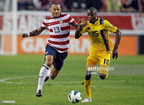 Midfielder Jermaine Jones of Team USA battles midfielder Lawson Robinson of Team Antigua and Barbuda for the ball during the FIFA World Cup Qualifier...
