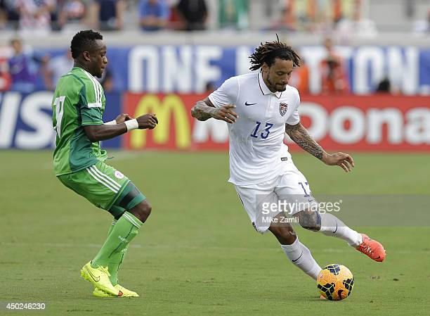 Midfielder Jermaine Jones of the United States dribbles past midfielder Ogenyi Onazi of Nigeria during the international friendly match at EverBank...
