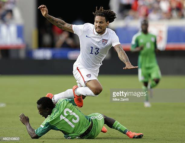 Midfielder Jermaine Jones of the United States is tripped up by defender Juwon Oshaniwa of Nigeria during the international friendly match at...