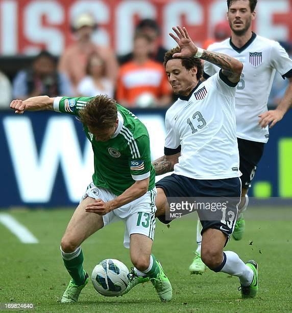 Midfielder Jermaine Jones , right, knocks Germany midfielder Nicolai Mueller to the turf during a battle for the ball in the second half of an...