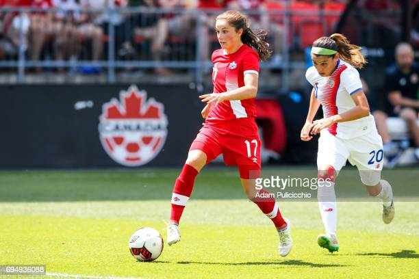 Midfielder Jessie Fleming of Team Canada pushes the ball on the attack as Defender Wendy Acosta of Team Costa Rica chases behind in a exhibition...