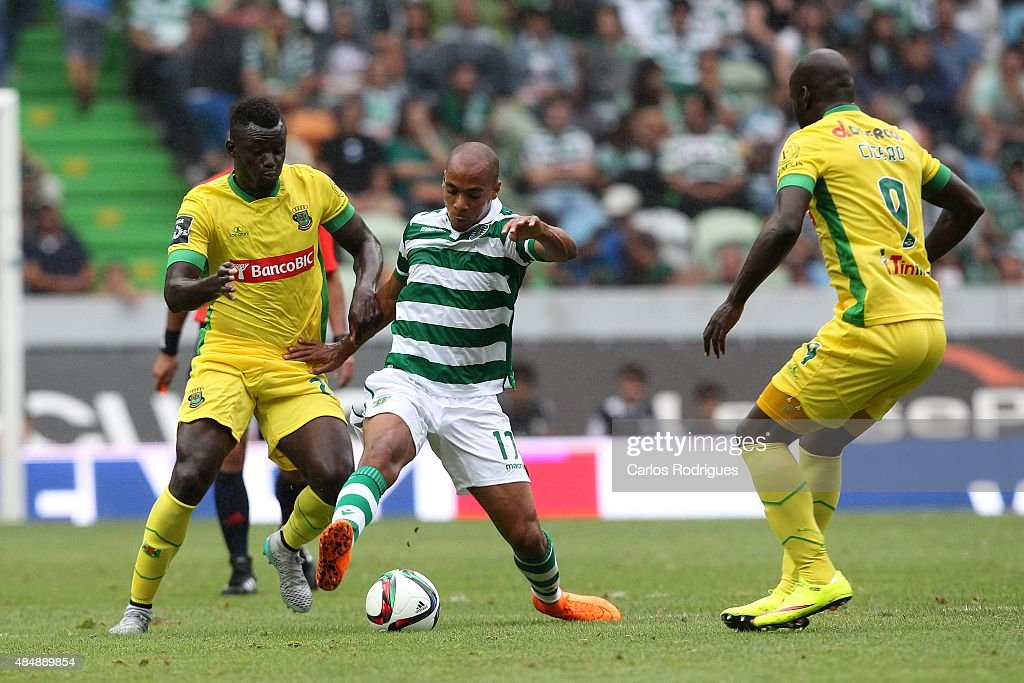 Midfielder Joao Mario of Sporting CP vies with midfielder Pele of FC Pacos Ferreira during the match between Sporting CP and FC Pacos de Ferreira at Jose Alvalade Stadium on August 22, 2015 in Lisbon, Portugal.