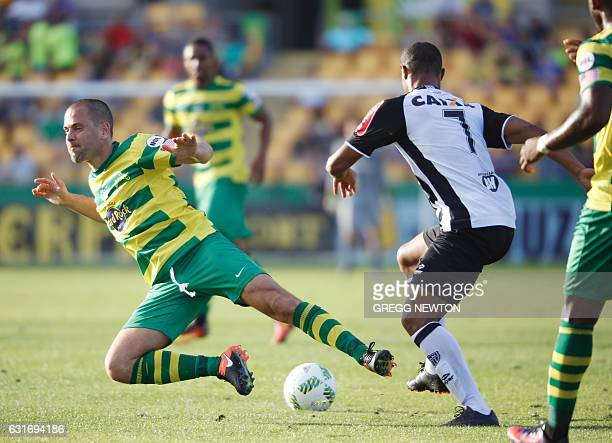 Midfielder Joe Cole of the Tampa Bay Rowdies is stripped of the ball by midfielder Lucas Candido of Brazilian club Atletico during their Florida Cup...